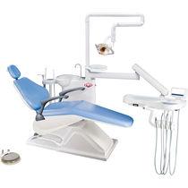 Riunito odontoiatrico con poltrona elettrica / con portastrumenti / con illuminazione