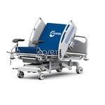 letto di parto / manuale / ad altezza regolabile / con rotelle